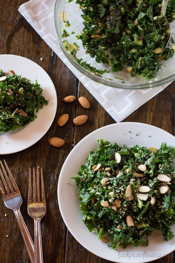 Overhead view of Kale and Avocado Salad with Sweet and Sour Dressing on a large plate, on a small plate and in a bowl
