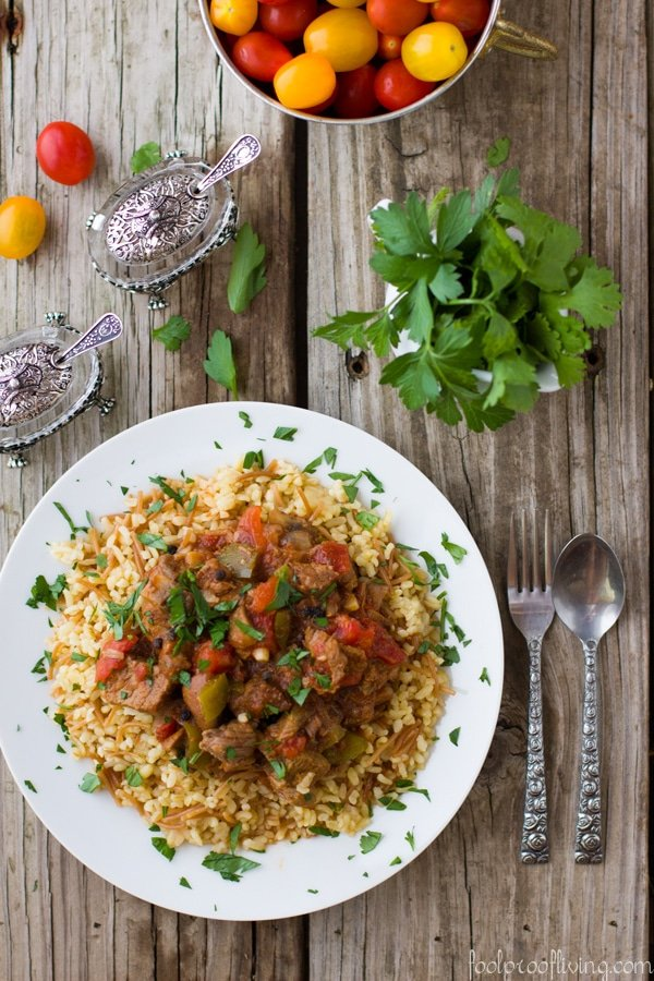 Beef Stew with bulgur wheat served with fresh tomatoes.