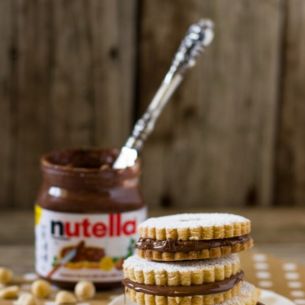 Nutella Sandwich Cookies with a jar of nutella