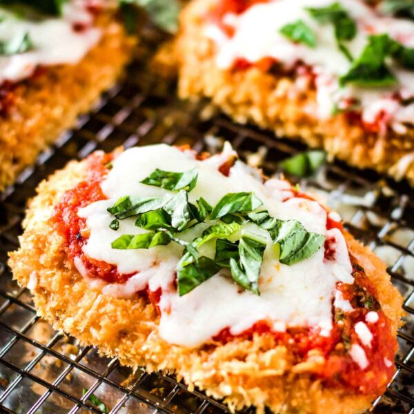 Oven Baked Chicken Parmesan topped off with tomato sauce and cheese