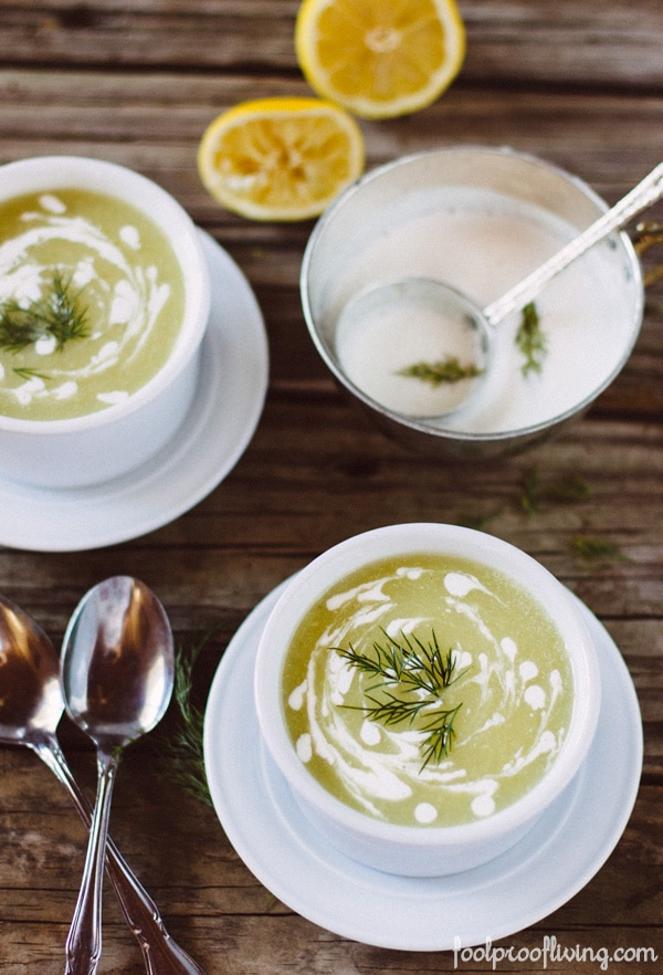 Zucchini Soup in a bowl with yogurt sauce on the side