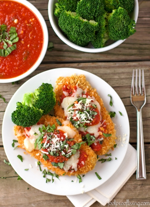 Oven Baked Chicken Parmesan: Our favorite Italian dish just got healthier. Skip all the frying and give this oven baked chicken parmesan recipe a try