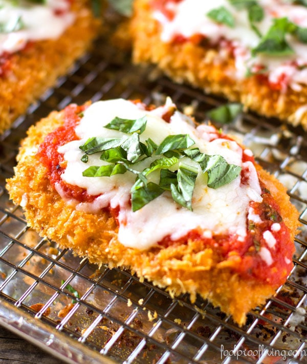 Baked Chicken Parmesan recipe topped off with cheese and basil