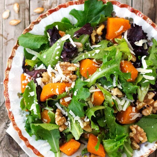 Roasted Butternut Squash Salad with warm cider vinaigrette on a plate