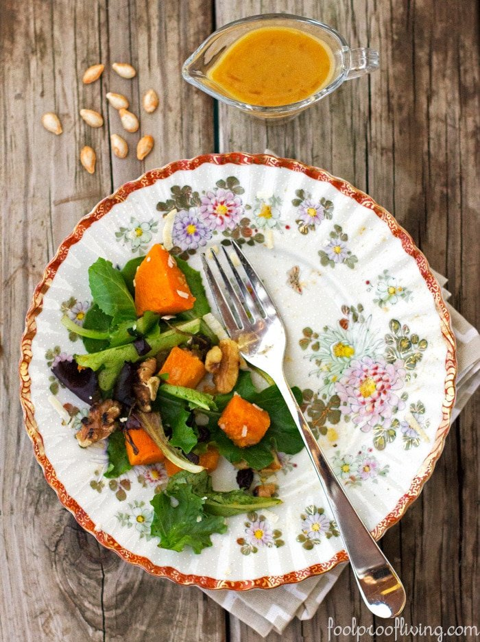 Roasted Butternut Squash Salad on a plate with a fork placed on a table