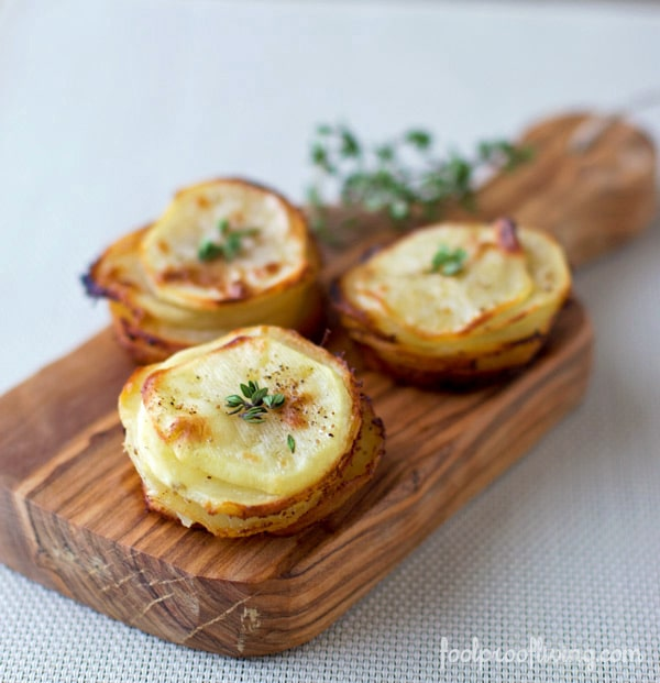 Potatoes cooked in muffin tin placed on a cutting board