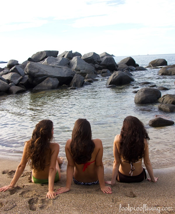 Women photographed from the back in the ocean