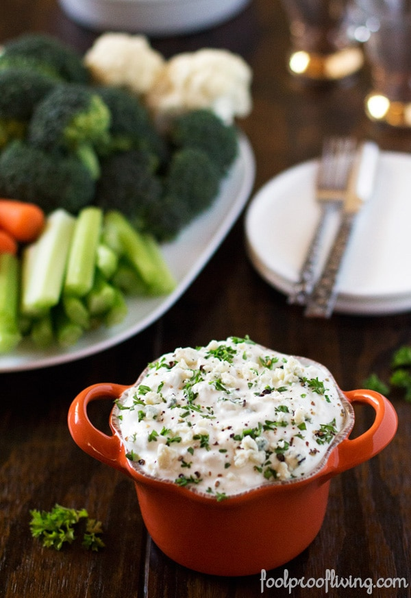 a bowl of blue cheese dip no sour cream garnished with parsley
