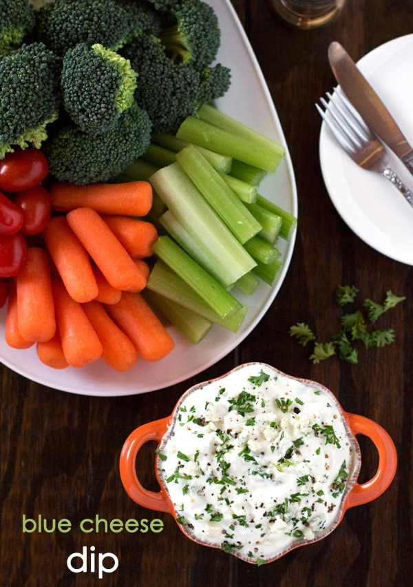 blue cheese dip without sour cream served with fresh vegetables around it
