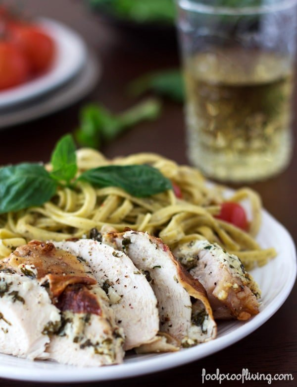 Chicken with Basil and Herbed Goat Cheese with pasta and a glass of wine