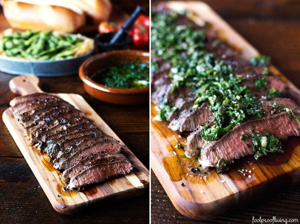 Sliced Chimichurri Steak on a platter with condiments in the background