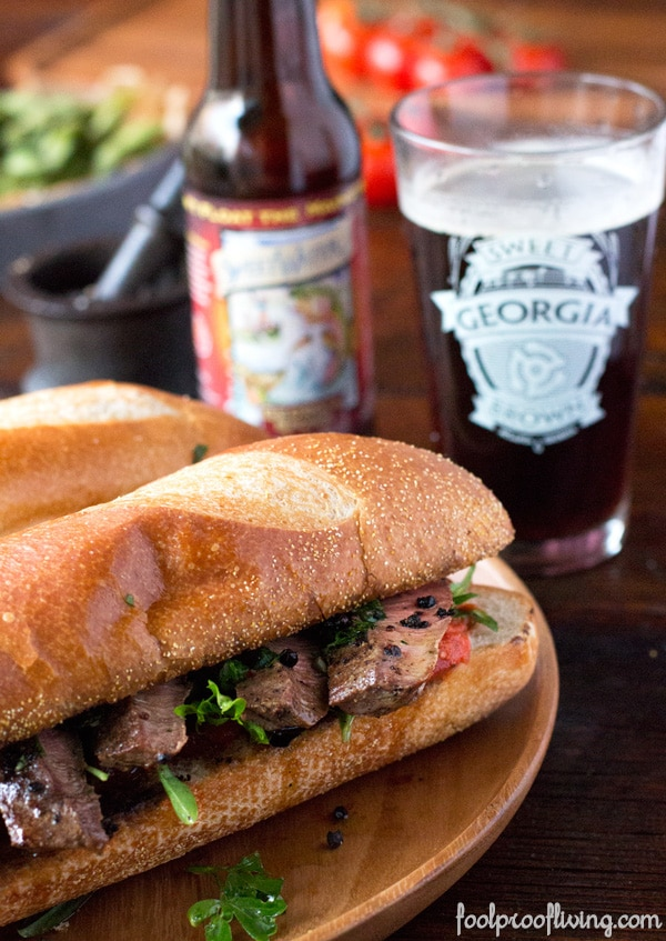 Chimichurri Steak Sandwich with a glass and a bottle of beer