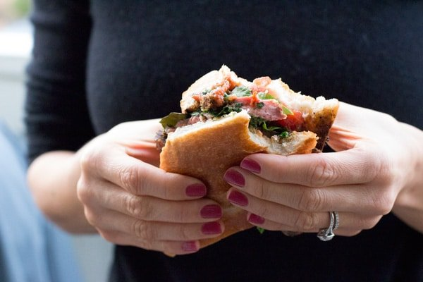 Person holding a Steak Sandwich