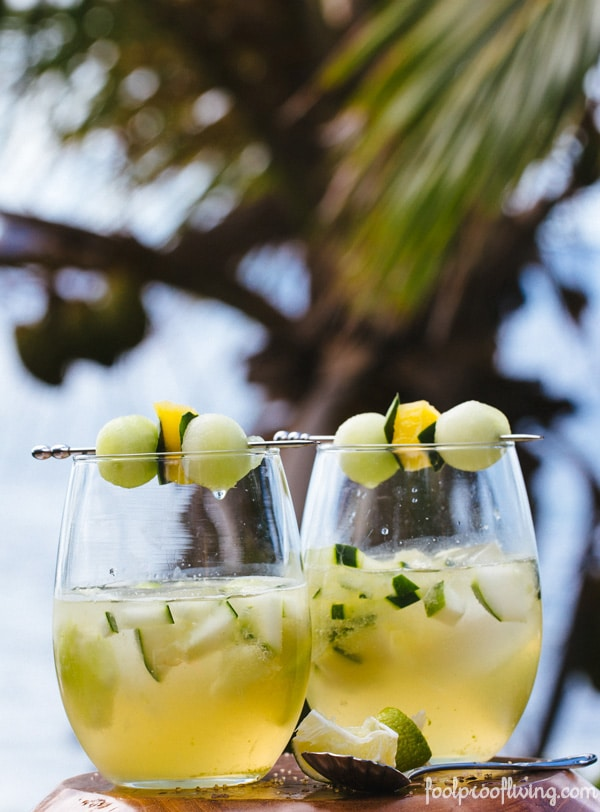 Two Women on the Rock A Caribbean Cocktails with garnishes on a table with a spoon