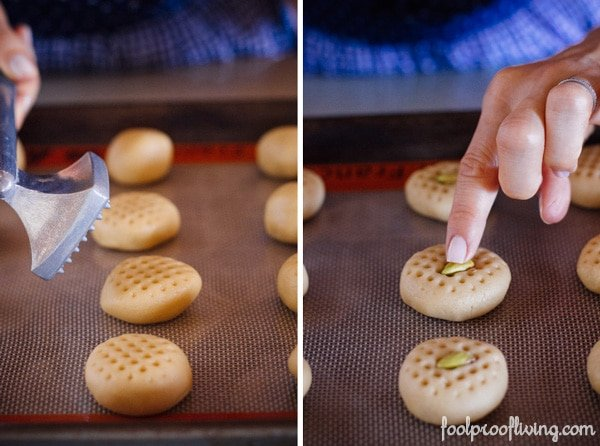 Person assembling Tahini Cookies with Pistachios on a sheet pan