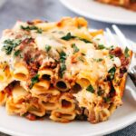 baked ziti with meat sauce sliced and placed on a plate