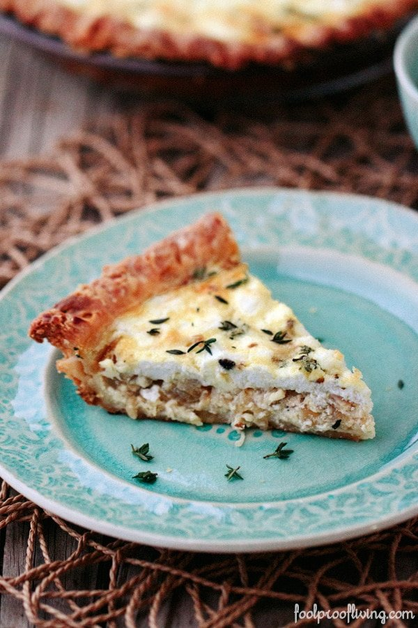Goat Cheese Quiche with Caramelized Onions and Thyme placed on a plate