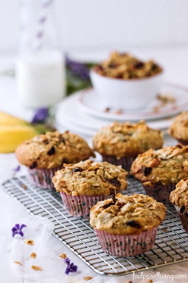 Banana and Coconut Muffins on a rack with bowl of granola