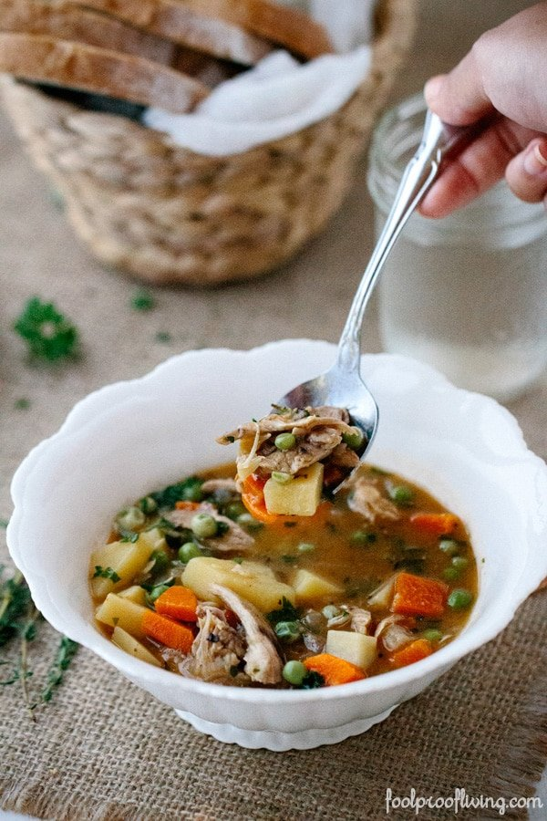A spoonful of Slow Cooker Chicken Stew from a bowl