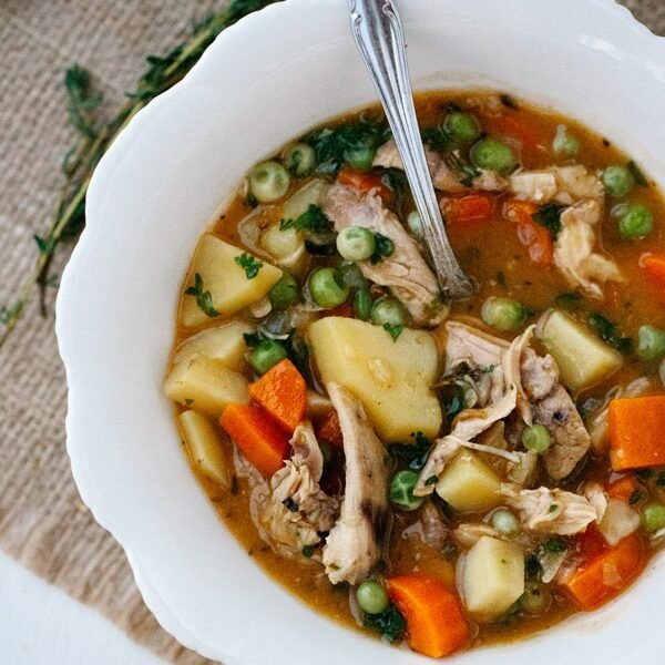 A spoonful from a bowl of Slow Cooker Chicken Stew