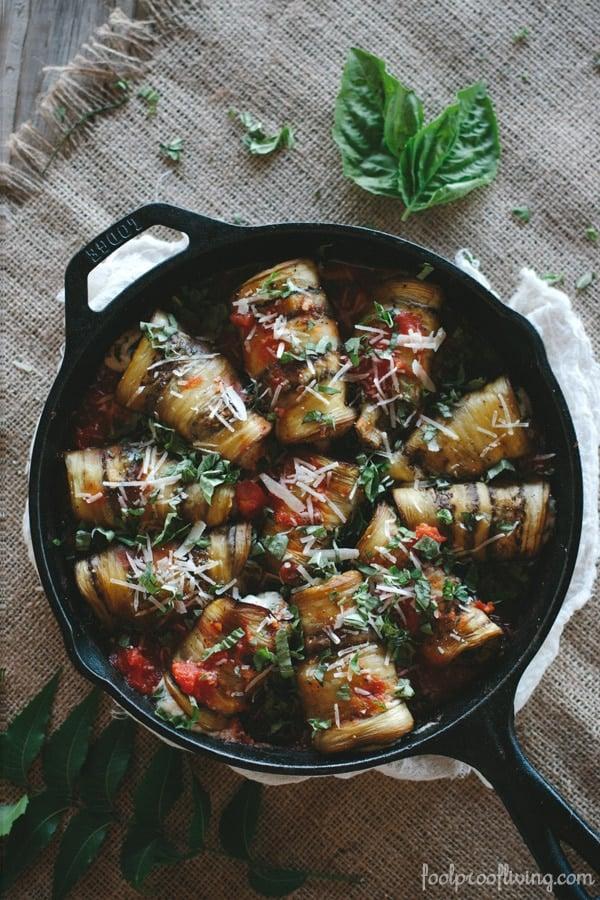 Eggplant Involtini in a cast iron skillet in tomato sauce