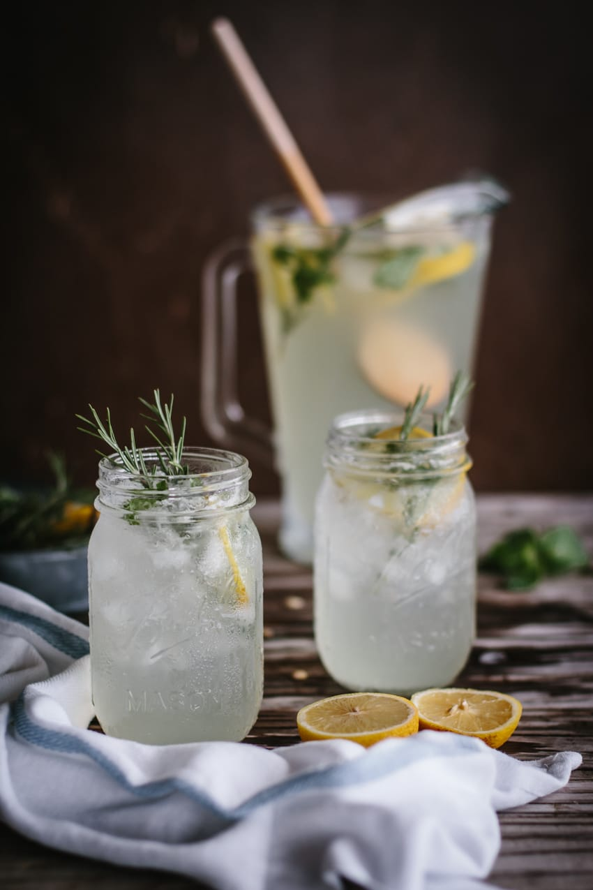 Mint and Rosemary Lemonade with Vanilla - A few mason jars filled with mint lemonade