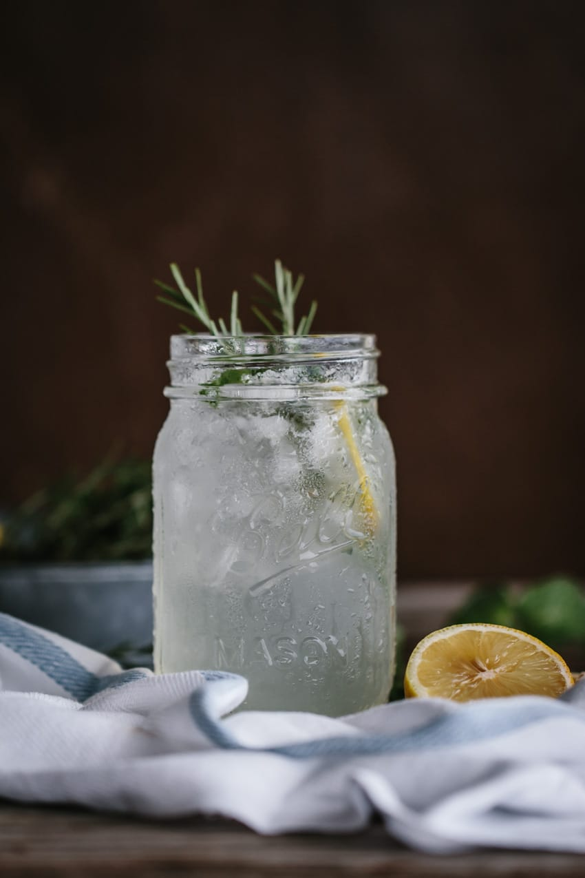 Fresh Mint Lemonade photographed with a garnish of rosemary from the front view.