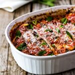 Zucchini Lasagna garnished with fresh herbs and cheese from the front view