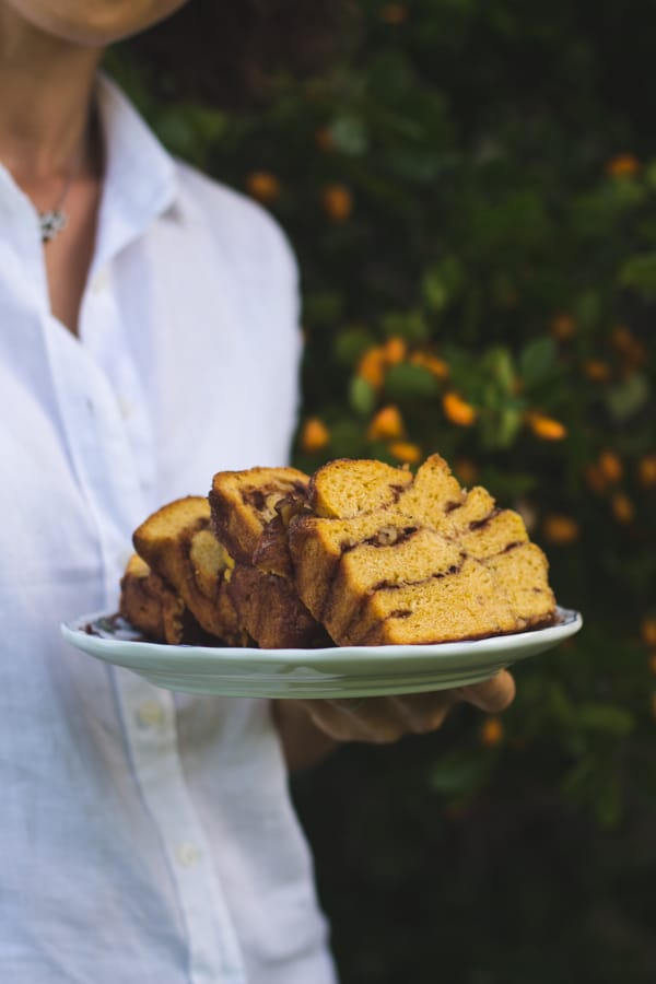 Person holding a plate of sliced Pumpkin Cinnamon Pull Apart Bread