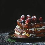 Side view of Brioche French Toast with Berries and Caramel Sauce