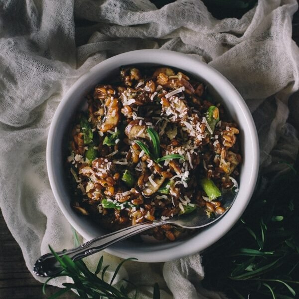 Overhead view of Mushroom and Asparagus Farro Risotto with Tarragon in a bowl