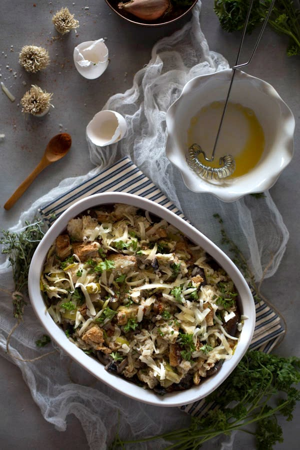 Prep for Vegetarian Brioche Stuffing recipe with ingredients combined in a casserole dish