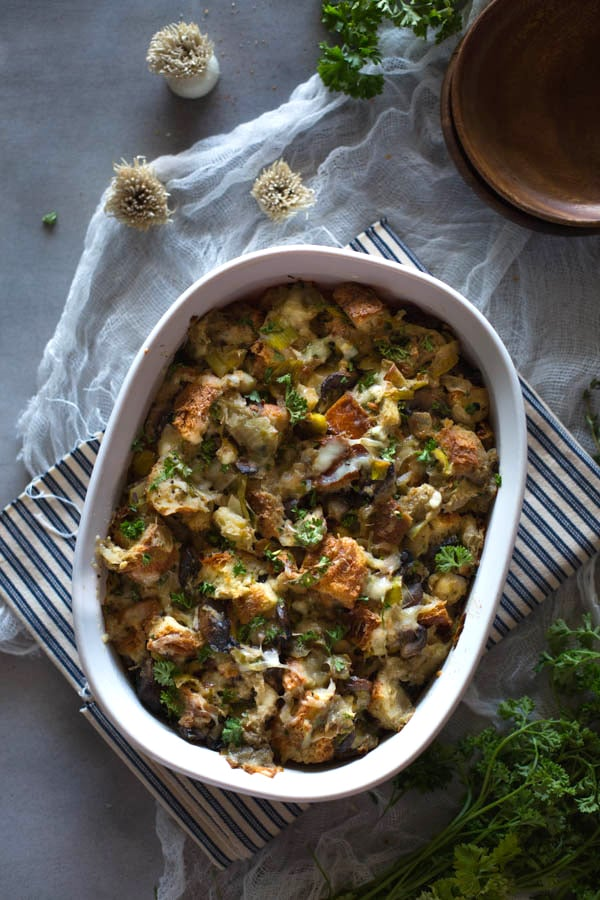 Overhead view of Wild Mushroom Stuffing in a casserole dish on a cloth napkin