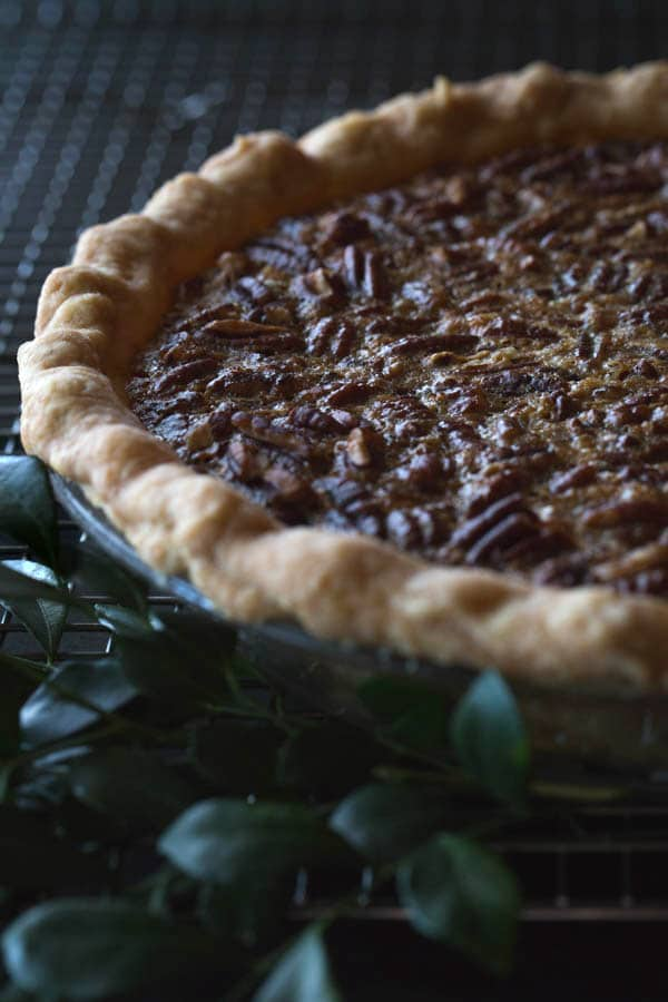 Close up frontal view of an Old-Fashioned Maple Pecan Pie with Bourbon Whipped Cream