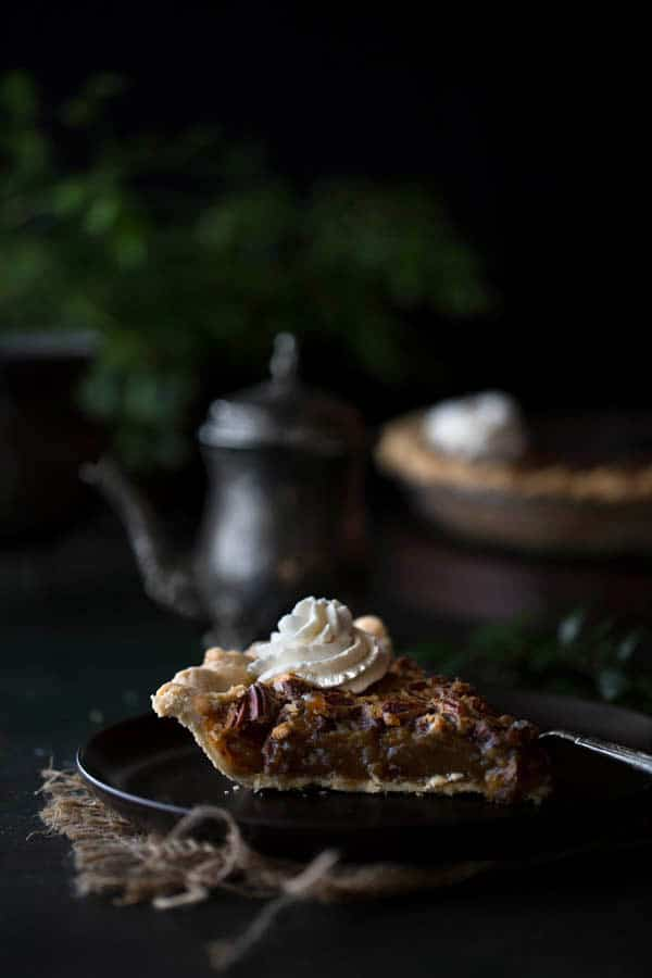 Single slice of homemade pie with Bourbon Whipped Cream