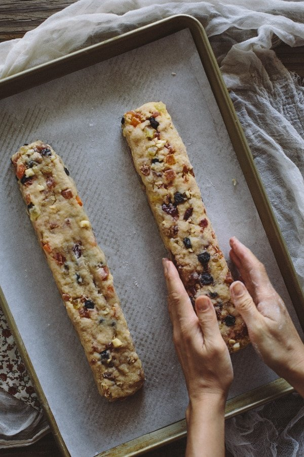 Two loaves of Caribbean Biscotti arranged on a sheet pan