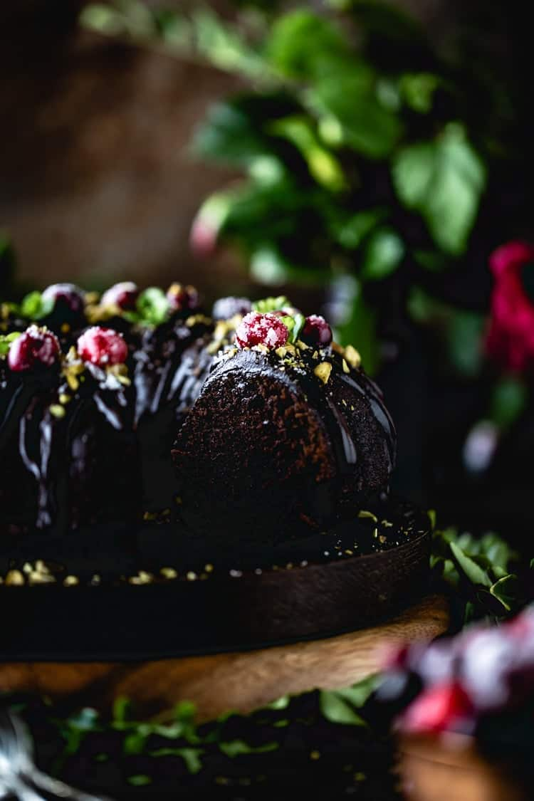 One of the best chocolate bundt cake recipes I have ever made photographed from the side. - Half eaten cake