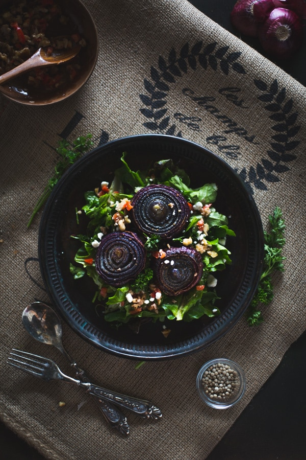 Overhead view of Roasted Red Onions with Walnut Salsa on a plate