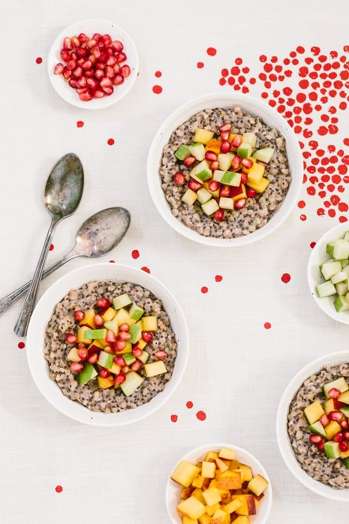 A few bowls of Overnight Coconut Buckwheat Porridge Recipe topped off with pomegranate seeds