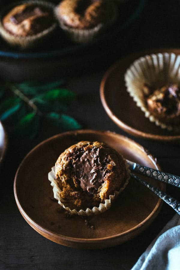 Close view of a single Banana Muffin with Toblerone Chunks