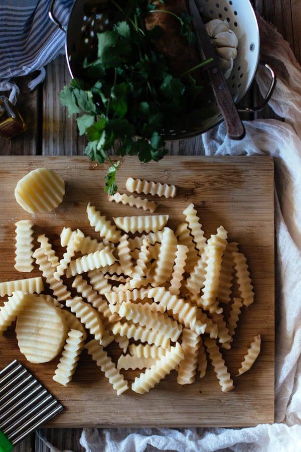 crinkled cut truffled fries prep work with herbs