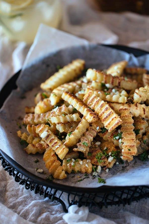 Seasoned Oven-Baked Crispy Truffled Fries in a bowl