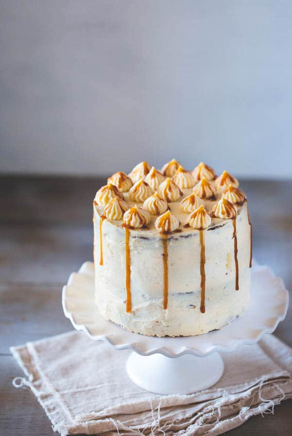 A 6 inch layered Banana Cake on a cake stand
