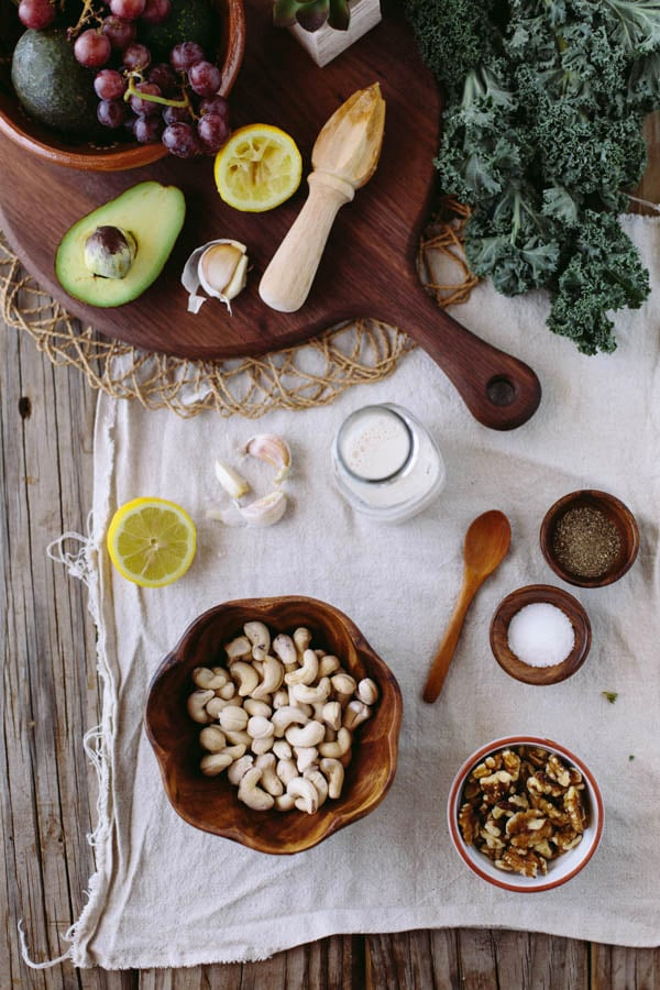 Ingredients for Chicken Salad recipes with wooden bowls, spoon and platter