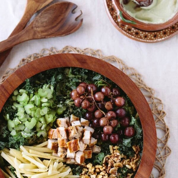 "Kale Waldorf Chicken Salad with Cashew and Avocado ""Mayo"" with a wooden spool"