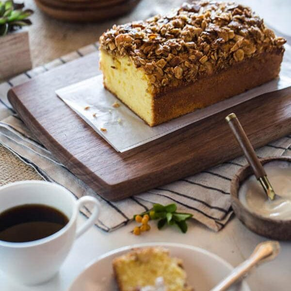 Sliced Orange Polenta Cake with Almond and Oat Streusel with a cup of coffee