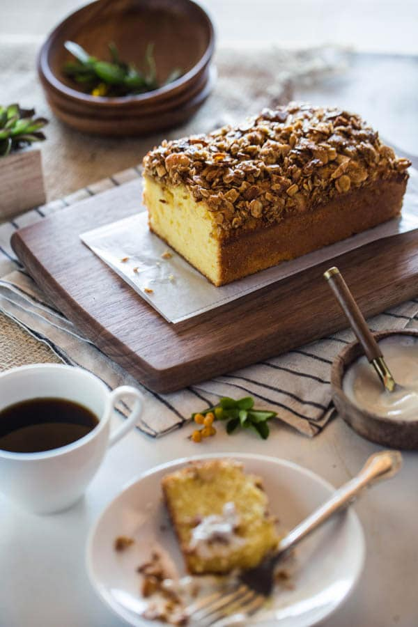 Orange Polenta Cake with Almond and Oat Streusel with a single slice of polenta cake