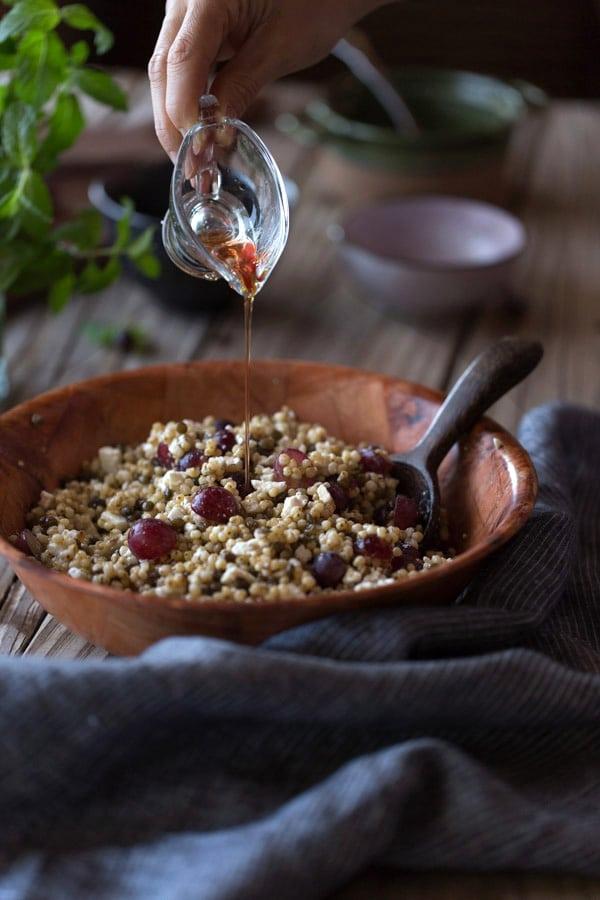Sorghum Pilaf with Lentils, Feta and Grapes: A GF and vegetarian sorghum pilaf bowl flavored with lentils, feta, and grapes.