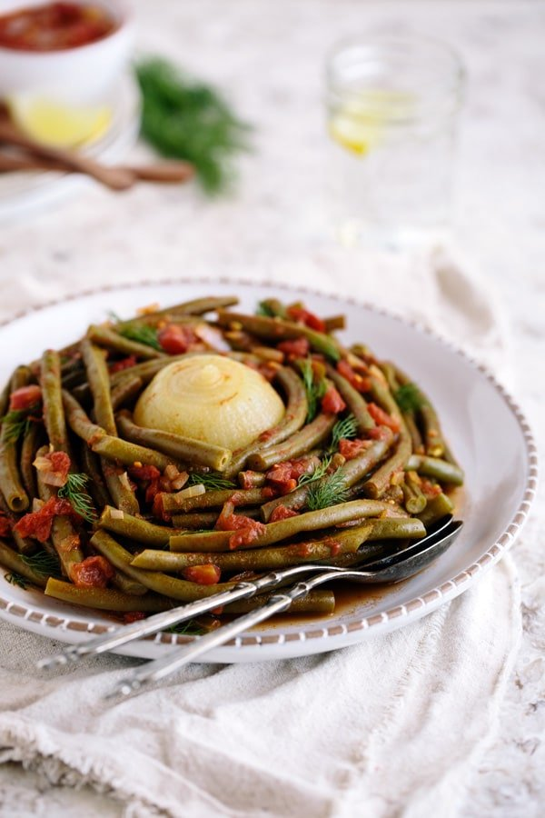 Easy Green bean salad placed on a plate and photographed from the front view.