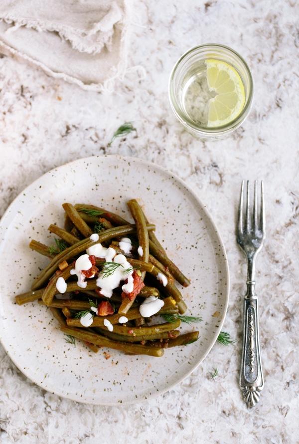 Cold green bean salad recipe topped off with garlic yogurt